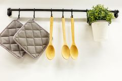Wooden spoons hanging in the kitchen stock image