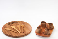 Wooden spoons on the kitchen board with wooden bowls Stock Photo