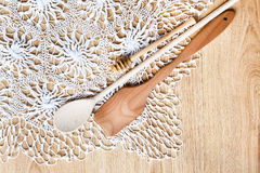 Wooden spoons on knitted lace tablecloth Stock Photos