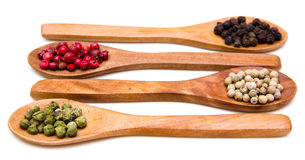 Wooden spoons with mixed peppers Stock Image