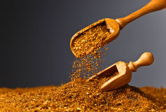 Wooden spoons with mixture of different  spices Stock Image