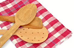 Wooden spoons on a napkin Stock Images