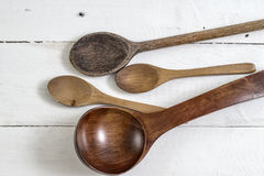 Wooden Spoons Over White Wooden Background Royalty Free Stock Image