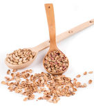 Wooden spoons with pistachios. Royalty Free Stock Images