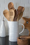 Wooden spoons. A pitcher of wooden spoons stock image