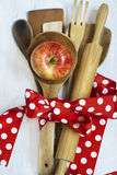 Wooden spoons, red tape lunar white wood background. Stock Photography
