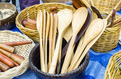 Wooden spoons for sale at street market Stock Photos