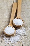 Wooden spoons with sea salt closeup on wooden rustic table. Background royalty free stock photography