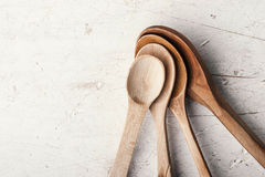 Wooden spoons set on the old white table Stock Photo