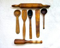Wooden spoons rocking shovels. Wooden spoons shovel rocking chair for a kitchen on a light background stock photography