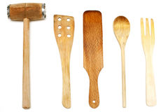 Wooden spoons, spatulas and hammer. Isolated stock images