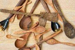 Wooden utensils on wooden background Stock Image