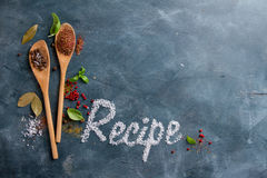Wooden spoons with spices and recipe word Stock Photo