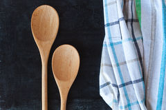 Wooden spoons and tablecloth Stock Photos