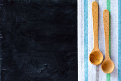 Wooden spoons and tablecloth Royalty Free Stock Photography