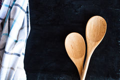 Wooden spoons and tablecloth Stock Images