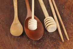 Wooden spoons on a timber board Stock Photos