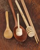 Wooden spoons on a timber board Royalty Free Stock Photography