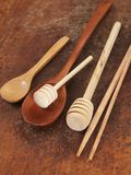 Wooden spoons on a timber board Stock Photo