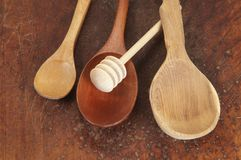 Wooden spoons on a timber board Royalty Free Stock Images