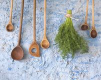 Wooden spoons w. dill herbs Royalty Free Stock Photography
