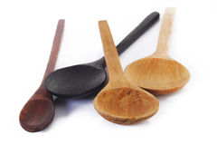 Wooden Spoons on white Stock Images