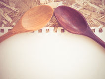 Wooden spoons on a wooden background Stock Image