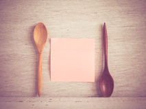 Wooden spoons on a wooden background Royalty Free Stock Photo