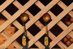 Wooden spoons on wooden background lattice Royalty Free Stock Images