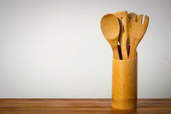 Wooden spoons in the wooden container.  stock photography