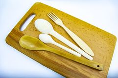 Wooden spoons on a wooden cutting board stock photography