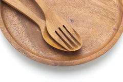 Wooden spoons in wooden plates Stock Photo