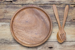 Wooden spoons, wooden plates Royalty Free Stock Image