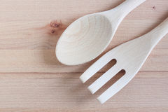 Wooden spoons and wooden repair on chopping wood background, Kitchenware Stock Images