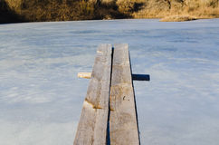 Wooden springboard overhang over ice water Royalty Free Stock Photo
