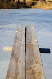 Wooden springboard overhang over ice water Stock Photography