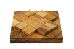 Wooden square figures assemble in puzzle isolated Royalty Free Stock Photo