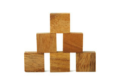 Wooden square figures in pyramid isolated Royalty Free Stock Photos