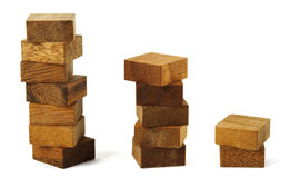 Wooden square figures in pyramid isolated Stock Images