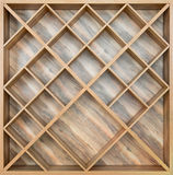Wooden square shelf for wine, or books of boards with a beautifu. L pattern Royalty Free Stock Images
