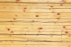 Wooden squared beam. Wall of the wooden squared beam with cracks Royalty Free Stock Photo