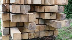 Wooden squared timbers for the building of wooden house stock video