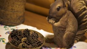 Wooden squirrel and cones. Inside the interior of an old wooden house.  stock video footage