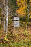 Wooden stable hunting blind hunting hide in a forest. Wooden stable hunting blind hunting hide in an autumn forest on the edge of field Royalty Free Stock Image