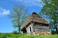 Wooden stable with thatched roof Royalty Free Stock Photos