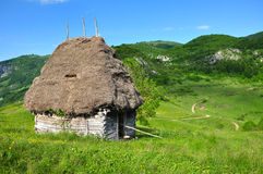 Wooden stable with thatched roof Royalty Free Stock Photography