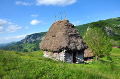 Wooden stable with thatched roof in the mountains Royalty Free Stock Images