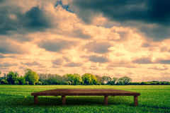 Wooden stage on a field. Countryside scenery with a wooden stage stock photography