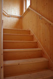 Wooden stair. Timber staircase in a new house Royalty Free Stock Photography