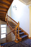 Wooden staircase. Solid wood staircase and hallway of a house with carpet runner stock image